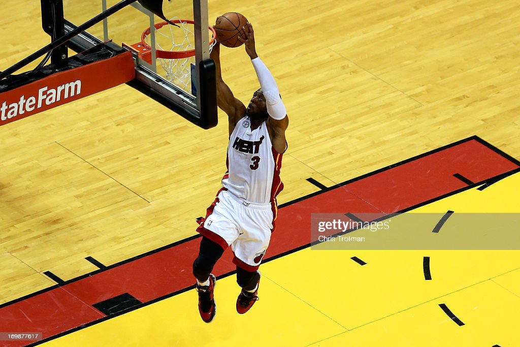 <a gi-track='captionPersonalityLinkClicked' href=/galleries/search?phrase=Dwyane+Wade&family=editorial&specificpeople=201481 ng-click='$event.stopPropagation()'>Dwyane Wade</a> #3 of the Miami Heat dunks in the first half against the Indiana Pacers during Game Seven of the Eastern Conference Finals of the 2013 NBA Playoffs at AmericanAirlines Arena on June 3, 2013 in Miami, Florida.