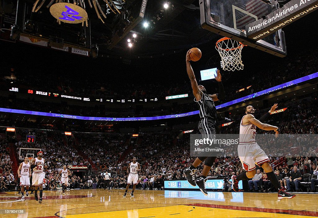<a gi-track='captionPersonalityLinkClicked' href=/galleries/search?phrase=Dwyane+Wade&family=editorial&specificpeople=201481 ng-click='$event.stopPropagation()'>Dwyane Wade</a> #3 of the Miami Heat dunks over <a gi-track='captionPersonalityLinkClicked' href=/galleries/search?phrase=Derrick+Rose&family=editorial&specificpeople=4212732 ng-click='$event.stopPropagation()'>Derrick Rose</a> #1 of the Chicago Bulls during a game at American Airlines Arena on January 29, 2012 in Miami, Florida.