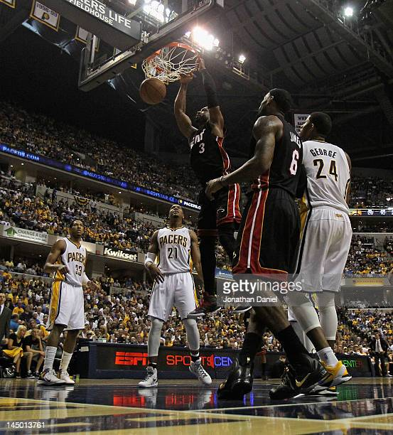 Dwyane Wade of the Miami Heat dunks over teammate LeBron James and Danny Granger David West and Paul George of the Indiana Pacers in Game Four of the...