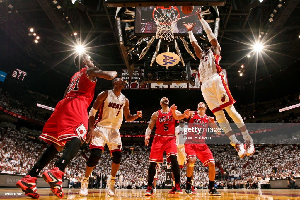 <a gi-track='captionPersonalityLinkClicked' href=/galleries/search?phrase=Dwyane+Wade&family=editorial&specificpeople=201481 ng-click='$event.stopPropagation()'>Dwyane Wade</a> #3 of the Miami Heat dunks the ball after catching an offensive rebound against the Chicago Bulls in Game Five of the Eastern Conference Semifinals during the 2013 NBA Playoffs on May 15, 2013 at American Airlines Arena in Miami, Florida.