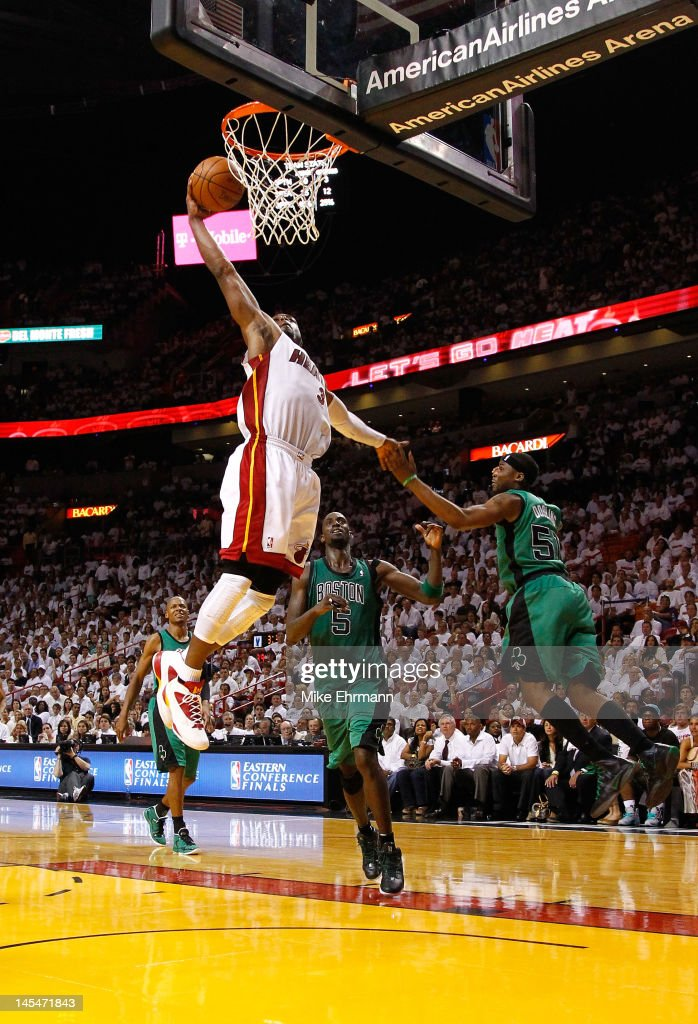 <a gi-track='captionPersonalityLinkClicked' href=/galleries/search?phrase=Dwyane+Wade&family=editorial&specificpeople=201481 ng-click='$event.stopPropagation()'>Dwyane Wade</a> #3 of the Miami Heat dunks the ball against <a gi-track='captionPersonalityLinkClicked' href=/galleries/search?phrase=Kevin+Garnett&family=editorial&specificpeople=201473 ng-click='$event.stopPropagation()'>Kevin Garnett</a> #5 and Keyon Dooling #51 of the Boston Celtics in Game Two of the Eastern Conference Finals in the 2012 NBA Playoffs on May 30, 2012 at American Airlines Arena in Miami, Florida.