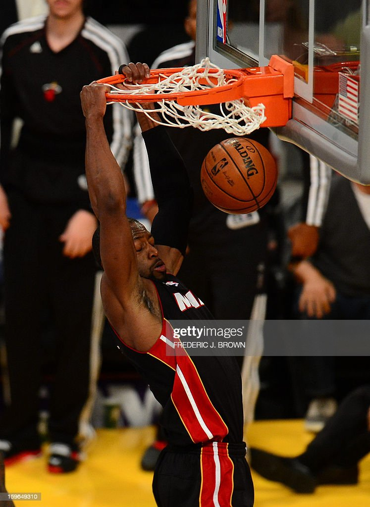 Dwyane Wade of the Miami Heat dunks the ball against Los Angeles Lakers during their NBA game on January 17, 2013 in Los Angeles, California. AFP PHOTO / Frederic J. BROWN
