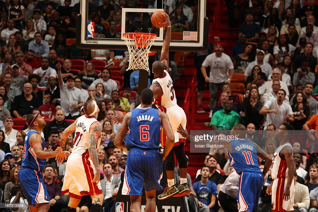 <a gi-track='captionPersonalityLinkClicked' href=/galleries/search?phrase=Dwyane+Wade&family=editorial&specificpeople=201481 ng-click='$event.stopPropagation()'>Dwyane Wade</a> #3 of the Miami Heat dunks the ball against the Los Angeles Clippers on November 7, 2013 at American Airlines Arena in Miami, Florida.