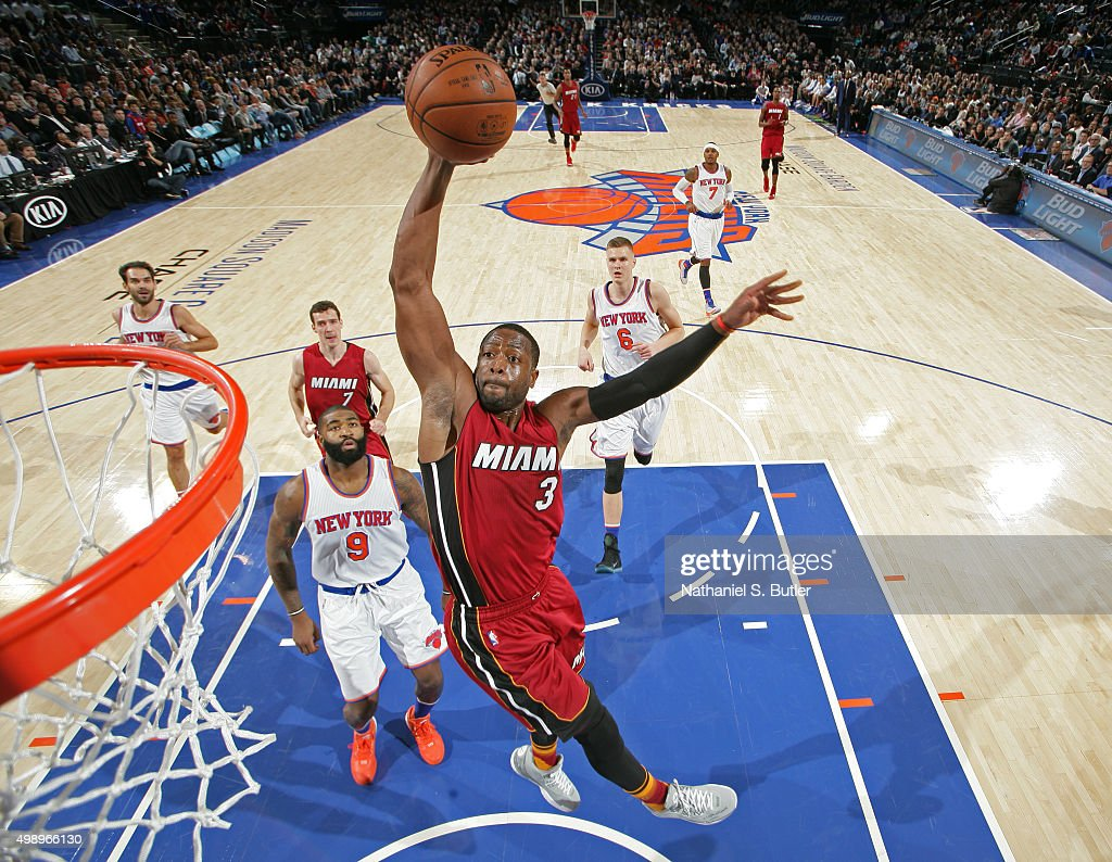 <a gi-track='captionPersonalityLinkClicked' href=/galleries/search?phrase=Dwyane+Wade&family=editorial&specificpeople=201481 ng-click='$event.stopPropagation()'>Dwyane Wade</a> #3 of the Miami Heat dunks the ball against the New York Knicks on November 27, 2015 at Madison Square Garden in New York City, New York.