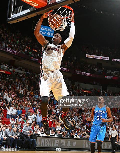Dwyane Wade of the Miami Heat dunks the ball against the Oklahoma City Thunder on December 3 2015 at American Airlines Arena in Miami Florida NOTE TO...
