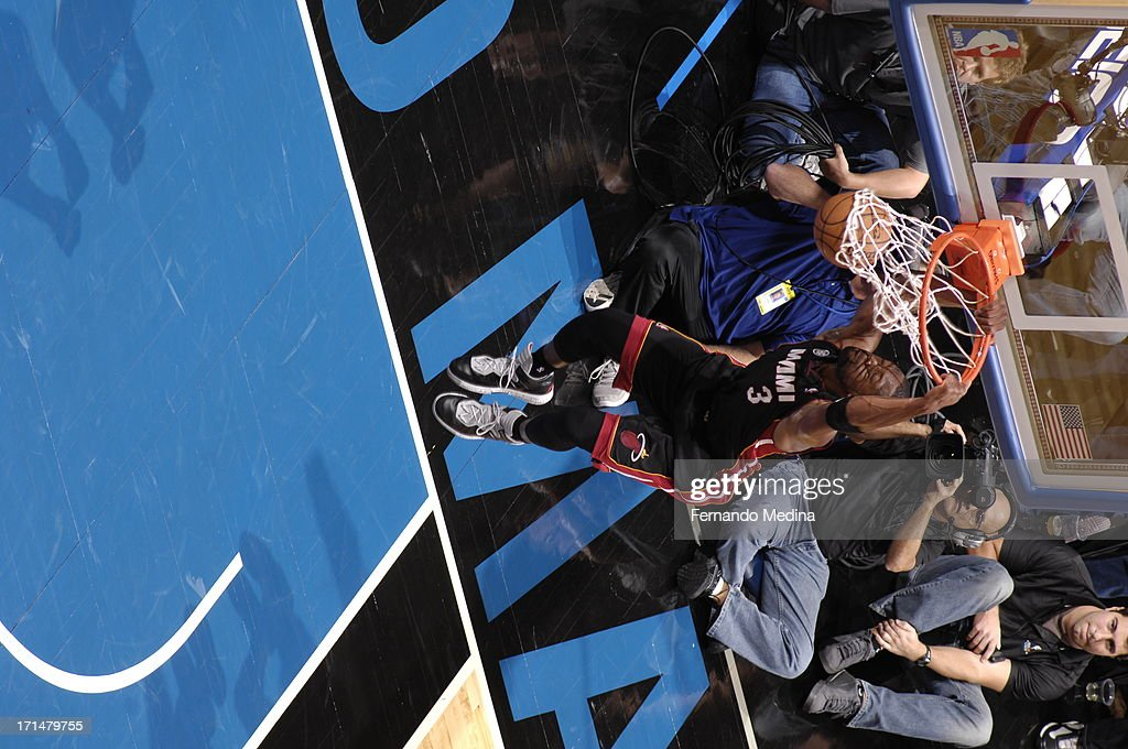 <a gi-track='captionPersonalityLinkClicked' href=/galleries/search?phrase=Dwyane+Wade&family=editorial&specificpeople=201481 ng-click='$event.stopPropagation()'>Dwyane Wade</a> #3 of the Miami Heat dunks the ball against the Orlando Magic on December 31, 2012 at Amway Center in Orlando, Florida.