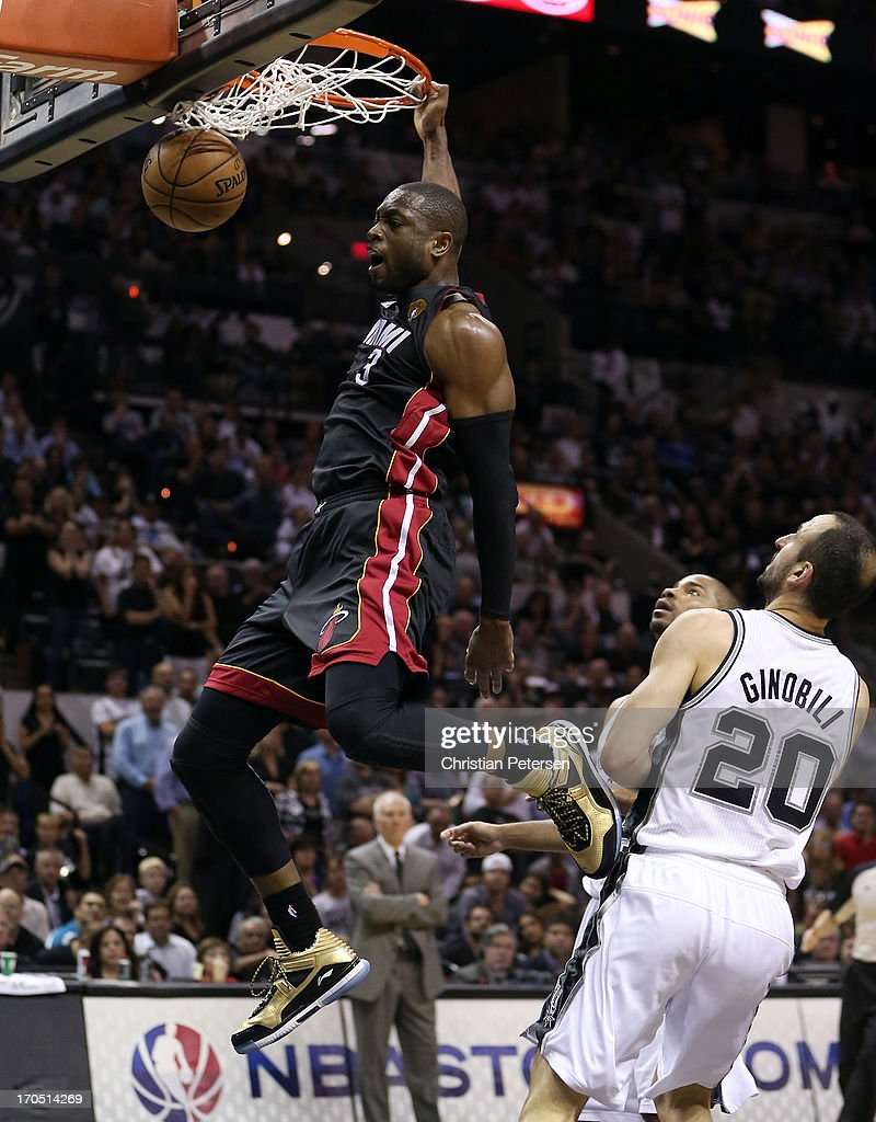 <a gi-track='captionPersonalityLinkClicked' href=/galleries/search?phrase=Dwyane+Wade&family=editorial&specificpeople=201481 ng-click='$event.stopPropagation()'>Dwyane Wade</a> #3 of the Miami Heat dunks the ball in front of Manu Ginobili #20 of the San Antonio Spurs in the fourth quarter during Game Four of the 2013 NBA Finals at the AT&T Center on June 13, 2013 in San Antonio, Texas.