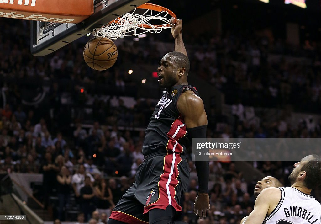 Dwyane Wade #3 of the Miami Heat dunks the ball in front of Manu Ginobili #20 of the San Antonio Spurs in the fourth quarter during Game Four of the 2013 NBA Finals at the AT&T Center on June 13, 2013 in San Antonio, Texas.
