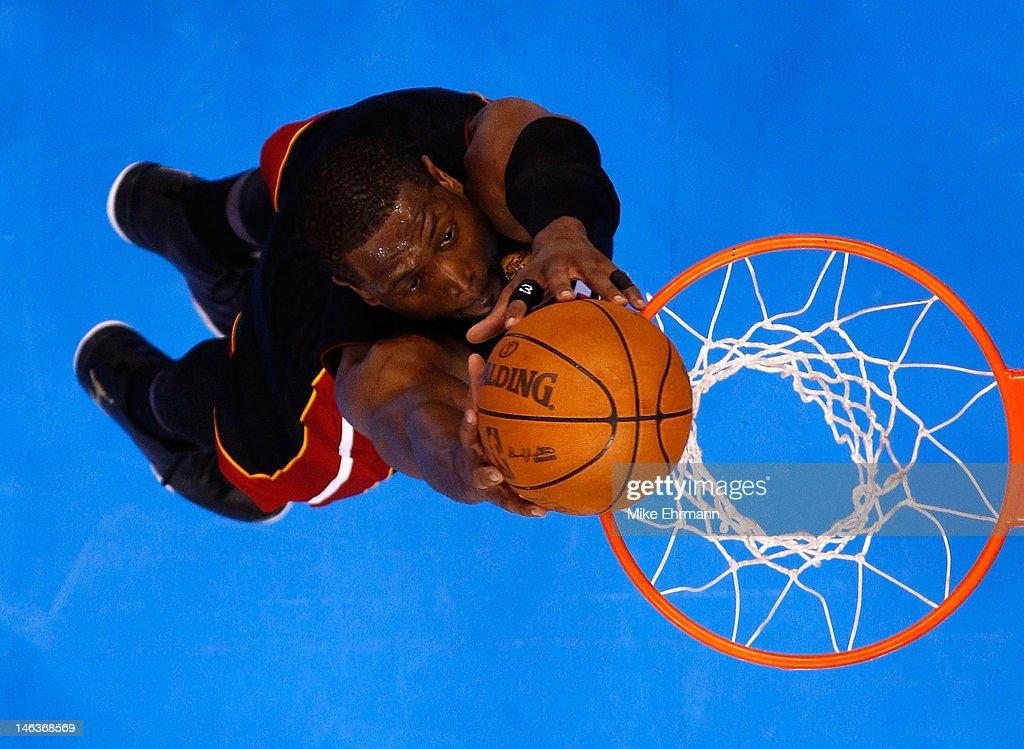 <a gi-track='captionPersonalityLinkClicked' href=/galleries/search?phrase=Dwyane+Wade&family=editorial&specificpeople=201481 ng-click='$event.stopPropagation()'>Dwyane Wade</a> #3 of the Miami Heat dunks the ball in the second half while taking on the Oklahoma City Thunder in Game Two of the 2012 NBA Finals at Chesapeake Energy Arena on June 14, 2012 in Oklahoma City, Oklahoma.