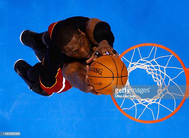Dwyane Wade of the Miami Heat dunks the ball in the second half while taking on the Oklahoma City Thunder in Game Two of the 2012 NBA Finals at...