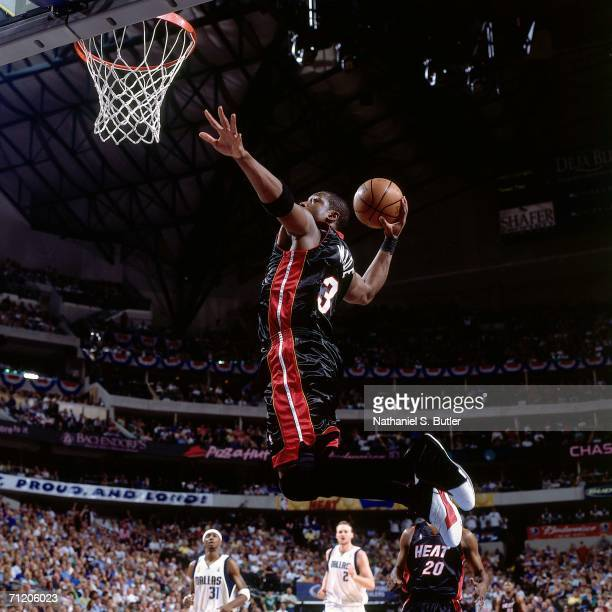 Dwyane Wade of the Miami Heat elevates for a dunk against the Dallas Mavericks during game two of the 2006 NBA Finals played June 11 2006 at the...