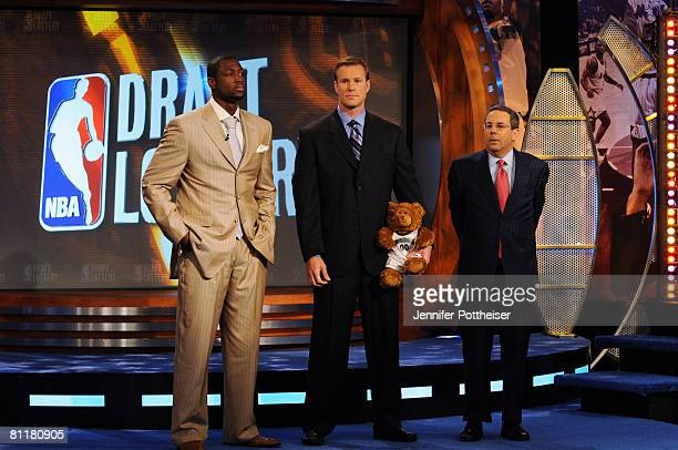 Dwyane Wade of the Miami Heat Fred Hoiberg Assistant General Manager of the Minnesota Timberwolves and Steve Schanwald Executive Vice President of...