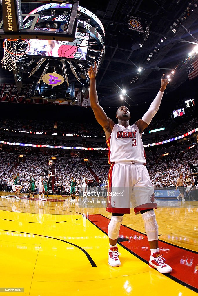 <a gi-track='captionPersonalityLinkClicked' href=/galleries/search?phrase=Dwyane+Wade&family=editorial&specificpeople=201481 ng-click='$event.stopPropagation()'>Dwyane Wade</a> #3 of the Miami Heat gestures towards the fans prior to the opening tip-off against the Miami Heat in Game Two of the Eastern Conference Finals in the 2012 NBA Playoffs on May 30, 2012 at American Airlines Arena in Miami, Florida.