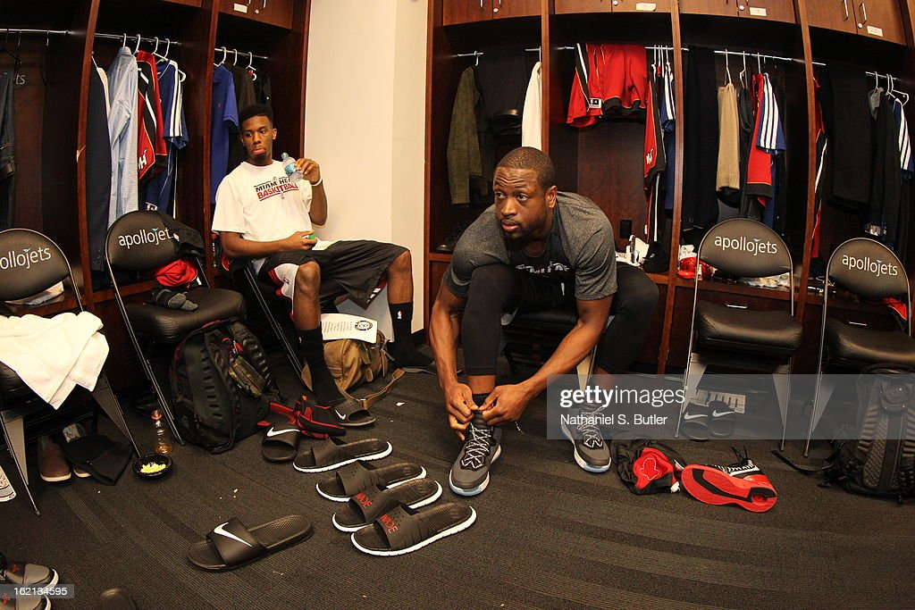<a gi-track='captionPersonalityLinkClicked' href=/galleries/search?phrase=Dwyane+Wade&family=editorial&specificpeople=201481 ng-click='$event.stopPropagation()'>Dwyane Wade</a> #3 of the Miami Heat gets ready before the game against the Brooklyn Nets on January 30, 2013 at the Barclays Center in the Brooklyn borough of New York City.