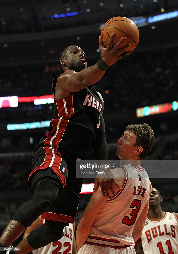 <a gi-track='captionPersonalityLinkClicked' href=/galleries/search?phrase=Dwyane+Wade&family=editorial&specificpeople=201481 ng-click='$event.stopPropagation()'>Dwyane Wade</a> #3 of the Miami Heat goes over Omer Asik #3 of the Chicago Bulls for a shot at the United Center on February 24, 2011 in Chicago, Illinois.