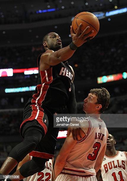 Dwyane Wade of the Miami Heat goes over Omer Asik of the Chicago Bulls for a shot at the United Center on February 24 2011 in Chicago Illinois NOTE...