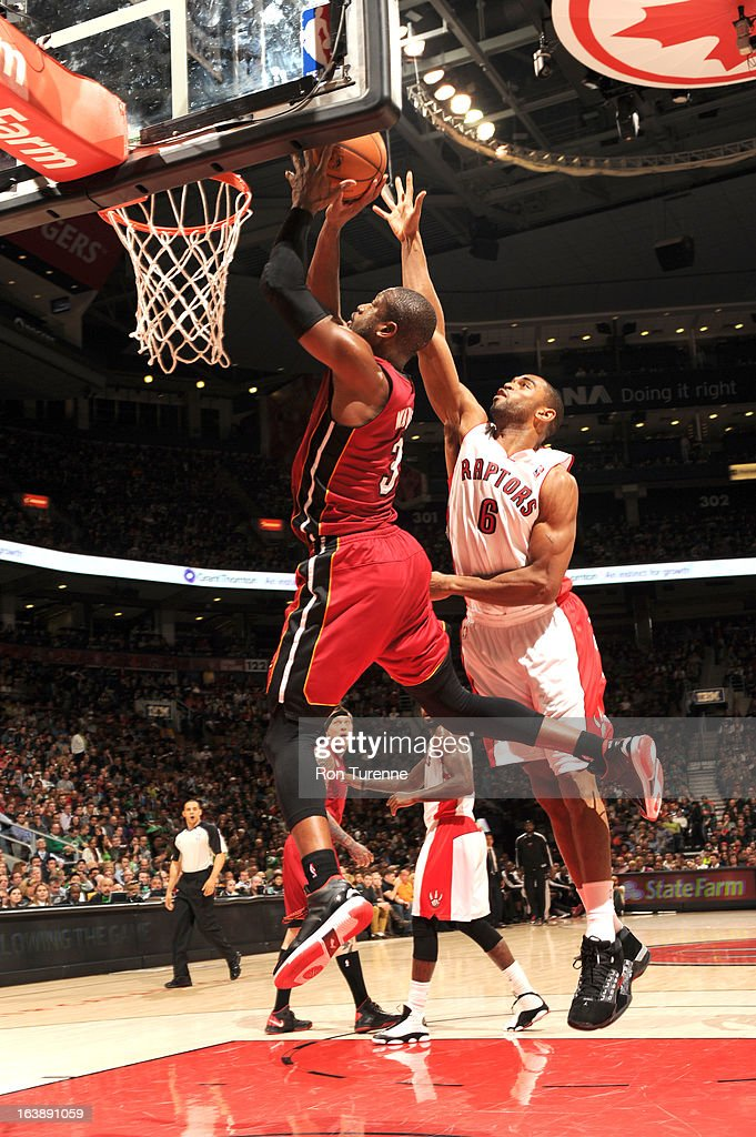Dwyane Wade #3 of the Miami Heat goes to the basket against Alan Anderson #6 of the Toronto Raptors during the game between the Toronto Raptors and the Miami Heat on March 17, 2013 at the Air Canada Centre in Toronto, Ontario, Canada.