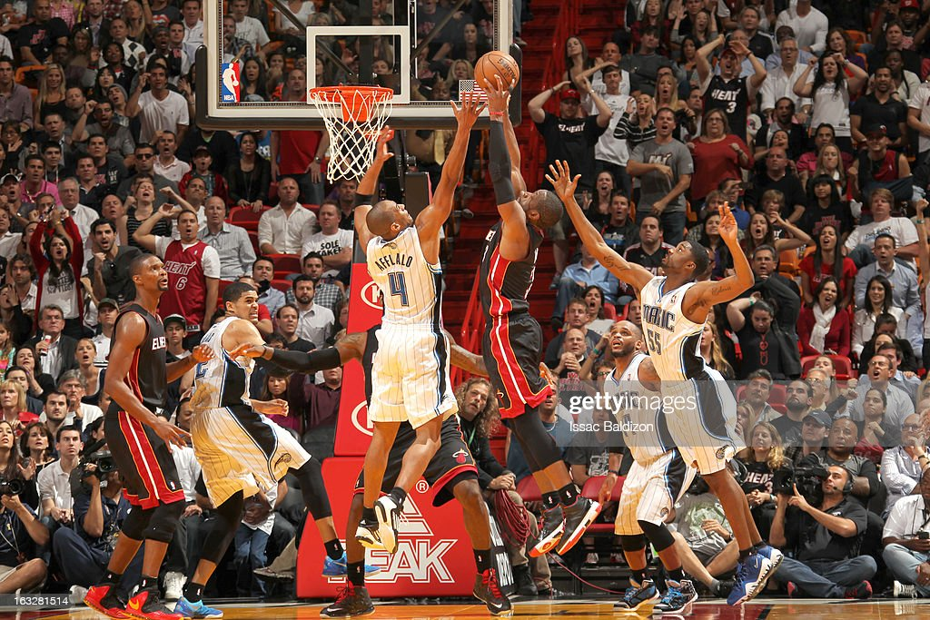 <a gi-track='captionPersonalityLinkClicked' href=/galleries/search?phrase=Dwyane+Wade&family=editorial&specificpeople=201481 ng-click='$event.stopPropagation()'>Dwyane Wade</a> #3 of the Miami Heat goes to the basket against <a gi-track='captionPersonalityLinkClicked' href=/galleries/search?phrase=Arron+Afflalo&family=editorial&specificpeople=640861 ng-click='$event.stopPropagation()'>Arron Afflalo</a> #4 of the Orlando Magic during the game between the Orlando Magic and the Miami Heat on March 6, 2013 at American Airlines Arena in Miami, Florida.