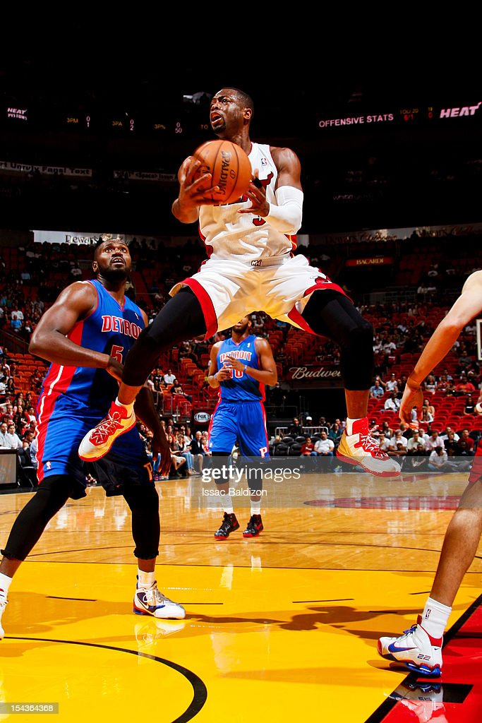 <a gi-track='captionPersonalityLinkClicked' href=/galleries/search?phrase=Dwyane+Wade&family=editorial&specificpeople=201481 ng-click='$event.stopPropagation()'>Dwyane Wade</a> #3 of the Miami Heat goes to the basket against <a gi-track='captionPersonalityLinkClicked' href=/galleries/search?phrase=Jason+Maxiell&family=editorial&specificpeople=651723 ng-click='$event.stopPropagation()'>Jason Maxiell</a> #54 of the Detroit Pistons during a pre-season game on October 18, 2012 at American Airlines Arena in Miami, Florida.