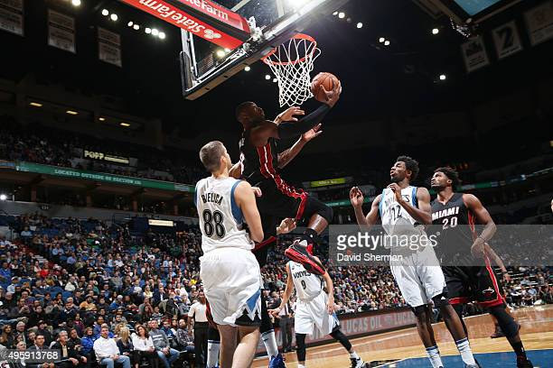 Dwyane Wade of the Miami Heat goes to the basket against the Minnesota Timberwolves on November 5 2015 at Target Center in Minneapolis Minnesota NOTE...