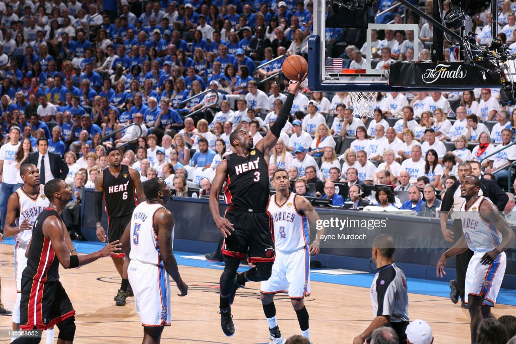 <a gi-track='captionPersonalityLinkClicked' href=/galleries/search?phrase=Dwyane+Wade&family=editorial&specificpeople=201481 ng-click='$event.stopPropagation()'>Dwyane Wade</a> #3 of the Miami Heat goes to the basket between <a gi-track='captionPersonalityLinkClicked' href=/galleries/search?phrase=Kendrick+Perkins&family=editorial&specificpeople=211461 ng-click='$event.stopPropagation()'>Kendrick Perkins</a> #5, <a gi-track='captionPersonalityLinkClicked' href=/galleries/search?phrase=Thabo+Sefolosha&family=editorial&specificpeople=587449 ng-click='$event.stopPropagation()'>Thabo Sefolosha</a> #2 and <a gi-track='captionPersonalityLinkClicked' href=/galleries/search?phrase=Serge+Ibaka&family=editorial&specificpeople=5133378 ng-click='$event.stopPropagation()'>Serge Ibaka</a> #9 of the Oklahoma City Thunder during Game Two of the 2012 NBA Finals at Chesapeake Energy Arena on June 14, 2012 in Oklahoma City, Oklahoma.