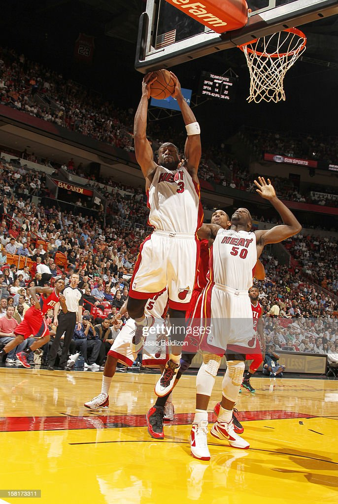 Dwyane Wade #3 of the Miami Heat goes to the basket during a game between the Atlanta Hawks and the Miami Heat on December 10, 2012 at American Airlines Arena in Miami, Florida.