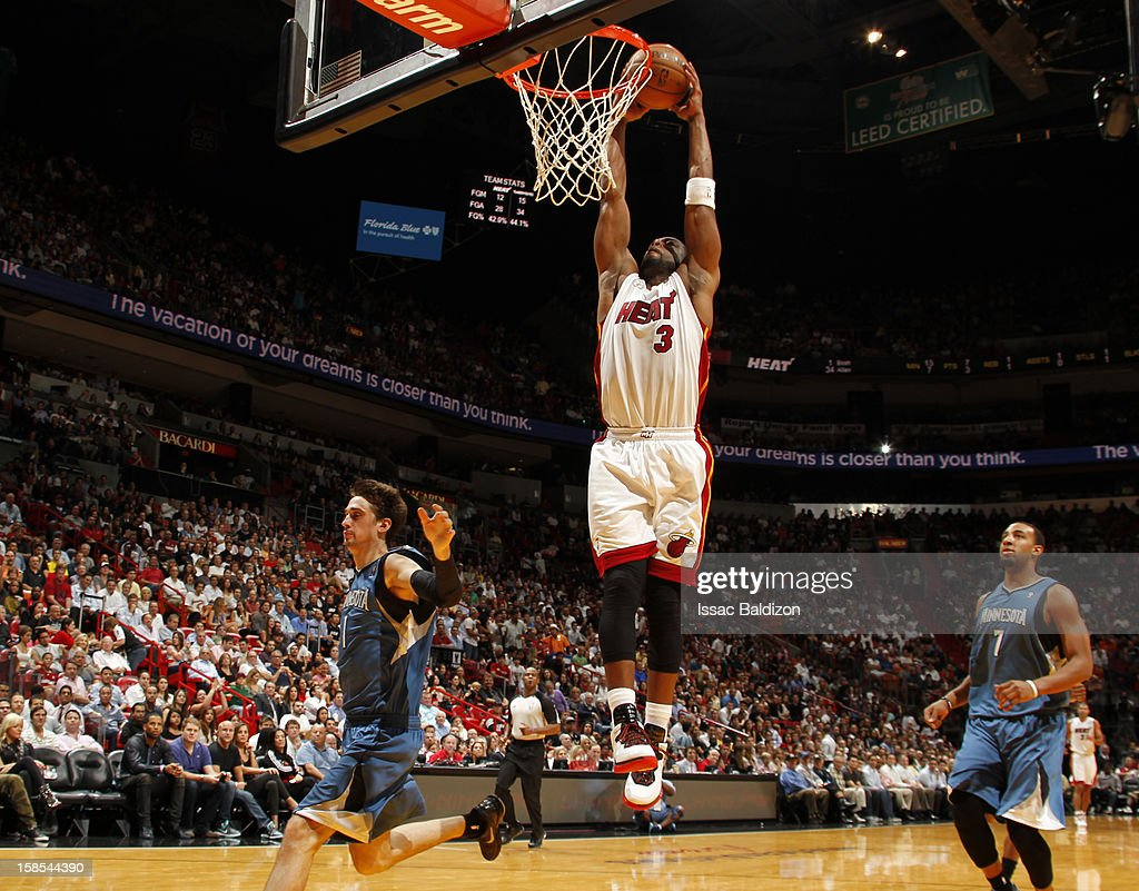 <a gi-track='captionPersonalityLinkClicked' href=/galleries/search?phrase=Dwyane+Wade&family=editorial&specificpeople=201481 ng-click='$event.stopPropagation()'>Dwyane Wade</a> #3 of the Miami Heat goes to the basket during a game between the Minnesota Timberwolves and the Miami Heat on December 18, 2012 at American Airlines Arena in Miami, Florida.