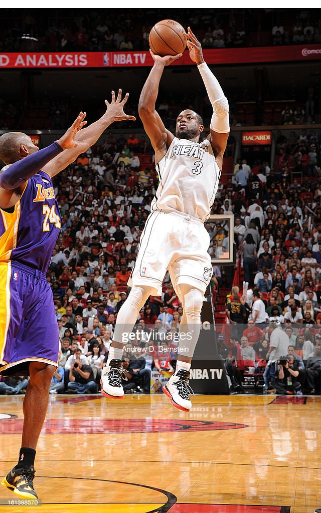 Dwyane Wade #3 of the Miami Heat goes to the basket during a game between the Los Angeles Lakers and the Miami Heat on February 10, 2013 at American Airlines Arena in Miami, Florida.