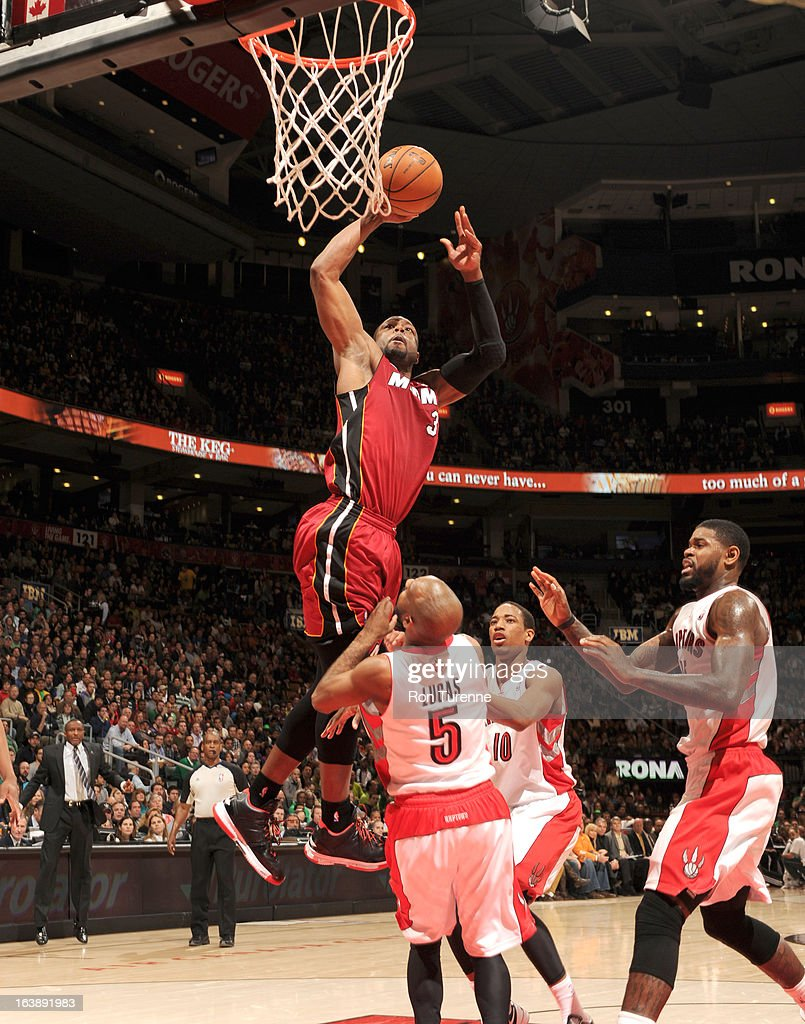 Dwyane Wade #3 of the Miami Heat goes to the basket during the game between the Toronto Raptors and the Miami Heat on March 17, 2013 at the Air Canada Centre in Toronto, Ontario, Canada.