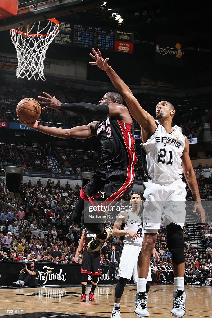 Dwyane Wade #3 of the Miami Heat goes up against Tim Duncan #21 of the San Antonio Spurs during Game Four of the 2013 NBA Finals on June 13, 2013 at the AT&T Center in San Antonio, Texas.