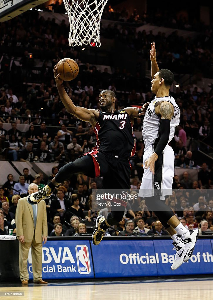 <a gi-track='captionPersonalityLinkClicked' href=/galleries/search?phrase=Dwyane+Wade&family=editorial&specificpeople=201481 ng-click='$event.stopPropagation()'>Dwyane Wade</a> #3 of the Miami Heat goes up for a shot against Danny Green #4 of the San Antonio Spurs in the second half during Game Five of the 2013 NBA Finals at the AT&T Center on June 16, 2013 in San Antonio, Texas.