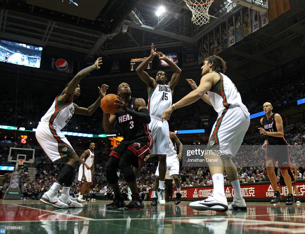 <a gi-track='captionPersonalityLinkClicked' href=/galleries/search?phrase=Dwyane+Wade&family=editorial&specificpeople=201481 ng-click='$event.stopPropagation()'>Dwyane Wade</a> #3 of the Miami Heat goes up for a shot against (L-R) Larry Sanders #8, <a gi-track='captionPersonalityLinkClicked' href=/galleries/search?phrase=John+Salmons&family=editorial&specificpeople=202524 ng-click='$event.stopPropagation()'>John Salmons</a> #15 and <a gi-track='captionPersonalityLinkClicked' href=/galleries/search?phrase=Andrew+Bogut&family=editorial&specificpeople=207105 ng-click='$event.stopPropagation()'>Andrew Bogut</a> #6 of the Milwaukee Bucks at the Bradley Center on December 6, 2010 in Milwaukee, Wisconsin. The Heat defeated the Bucks 88-78.