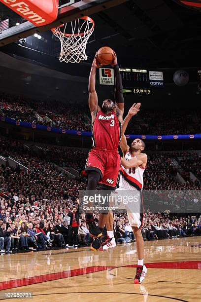 Dwyane Wade of the Miami Heat goes up for a shot against Nicolas Batum of the Portland Trail Blazers during a game on January 9 2011 at the Rose...
