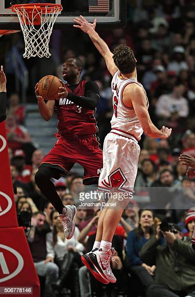Dwyane Wade of the Miami Heat goes up for a shot against Pau Gasol of the Chicago Bulls on his way to a gamehigh 28 points at the United Center on...