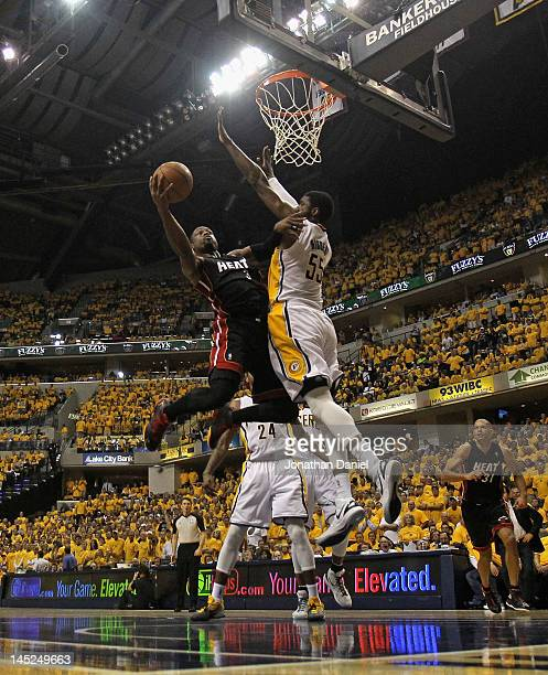 Dwyane Wade of the Miami Heat goes up for a shot against Roy Hibbert of the Indiana Pacers in Game Six of the Eastern Conference Semifinals in the...