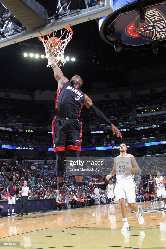 <a gi-track='captionPersonalityLinkClicked' href=/galleries/search?phrase=Dwyane+Wade&family=editorial&specificpeople=201481 ng-click='$event.stopPropagation()'>Dwyane Wade</a> #3 of the Miami Heat goes up for the dunk against the New Orleans Pelicans during an NBA preseason game on October 23,2013 at the New Orleans Arena in New Orleans, Louisiana.