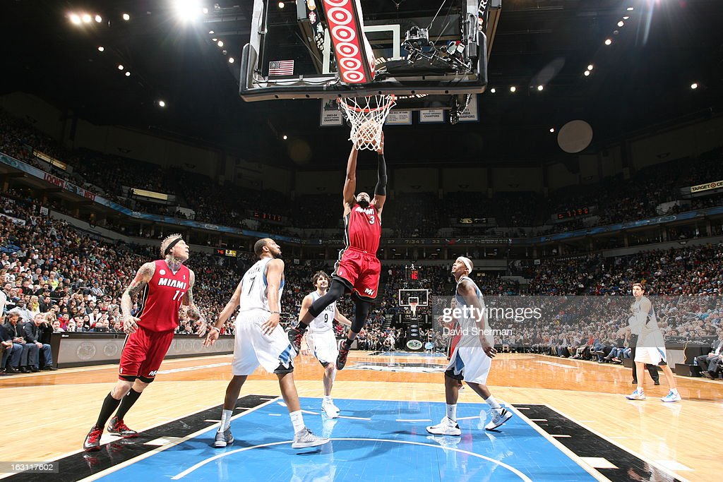Dwyane Wade #3 of the Miami Heat goes up for the dunk against the Minnesota Timberwolves during the game on March 4, 2013 at Target Center in Minneapolis, Minnesota.