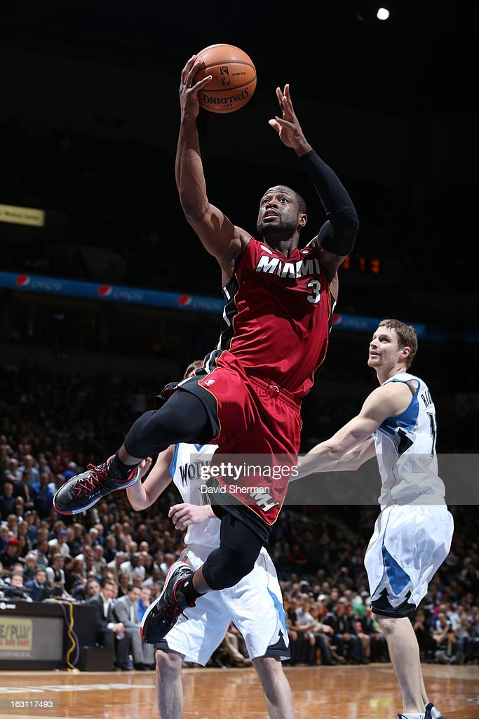 Dwyane Wade #3 of the Miami Heat goes up for the finger roll against the Minnesota Timberwolves during the game on March 4, 2013 at Target Center in Minneapolis, Minnesota.