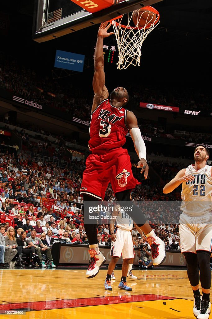 Dwyane Wade #3 of the Miami Heat goes up for the layup against the Charlotte Bobcats during a game on February 4, 2013 at American Airlines Arena in Miami, Florida.