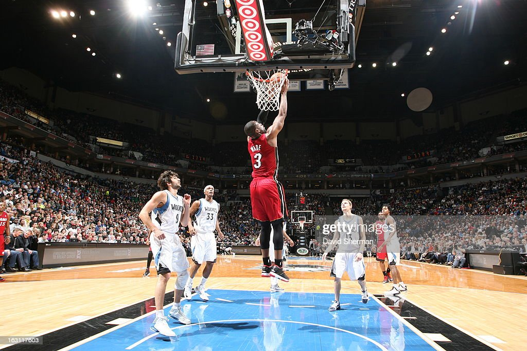 Dwyane Wade #3 of the Miami Heat goes up for the reverse dunk against the Minnesota Timberwolves during the game on March 4, 2013 at Target Center in Minneapolis, Minnesota.