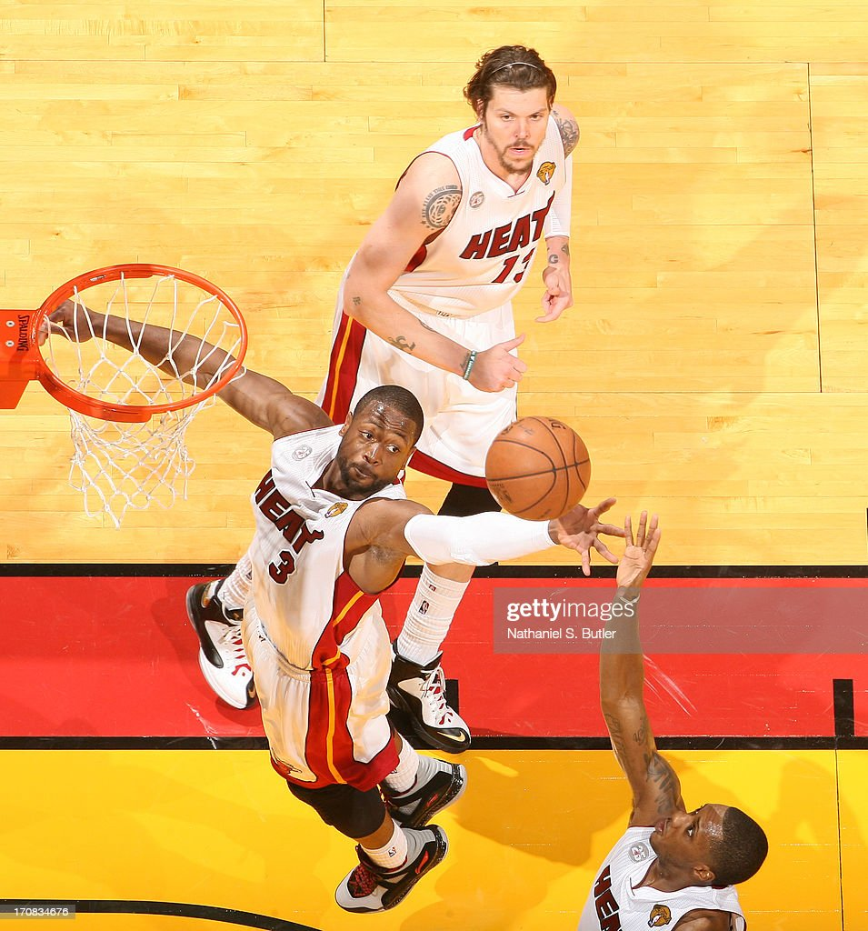 Dwyane Wade #3 of the Miami Heat goes up to rebound the ball while playing against the San Antonio Spurs in Game Six of the 2013 NBA Finals on June 18, 2013 at American Airlines Arena in Miami, Florida.