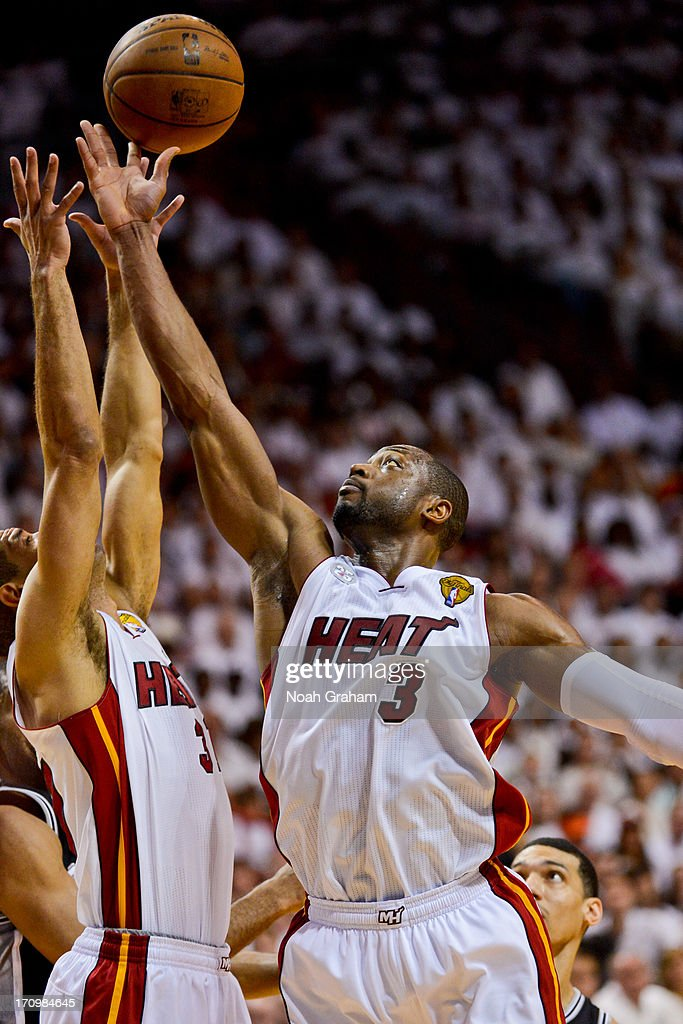 Dwyane Wade #3 of the Miami Heat grabs a rebound against the San Antonio Spurs during Game Seven of the 2013 NBA Finals on June 20, 2013 at American Airlines Arena in Miami, Florida.