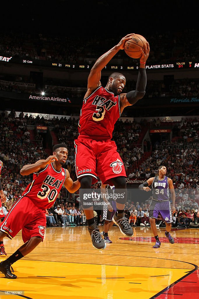 <a gi-track='captionPersonalityLinkClicked' href=/galleries/search?phrase=Dwyane+Wade&family=editorial&specificpeople=201481 ng-click='$event.stopPropagation()'>Dwyane Wade</a> #3 of the Miami Heat grabs the rebound against the Sacramento Kings on February 26, 2013 at American Airlines Arena in Miami, Florida.