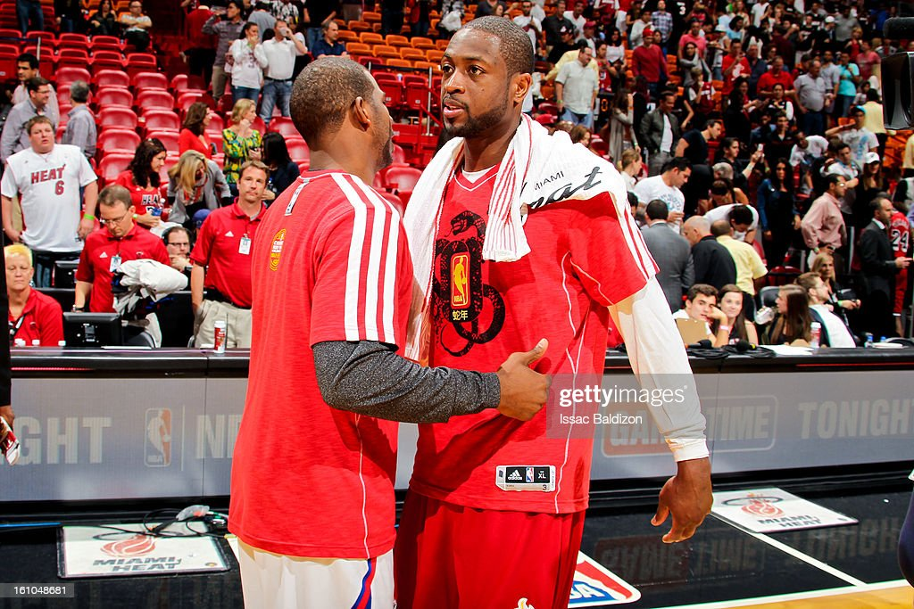 <a gi-track='captionPersonalityLinkClicked' href=/galleries/search?phrase=Dwyane+Wade&family=editorial&specificpeople=201481 ng-click='$event.stopPropagation()'>Dwyane Wade</a> #3 of the Miami Heat greets <a gi-track='captionPersonalityLinkClicked' href=/galleries/search?phrase=Chris+Paul&family=editorial&specificpeople=212762 ng-click='$event.stopPropagation()'>Chris Paul</a> #3 of the Los Angeles Clippers following their game on February 8, 2013 at American Airlines Arena in Miami, Florida.