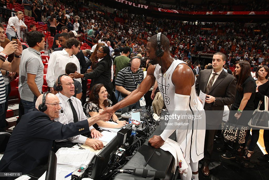 Dwyane Wade #3 of the Miami Heat greets commentators after a game between the Los Angeles Lakers and the Miami Heat on February 10, 2013 at American Airlines Arena in Miami, Florida.