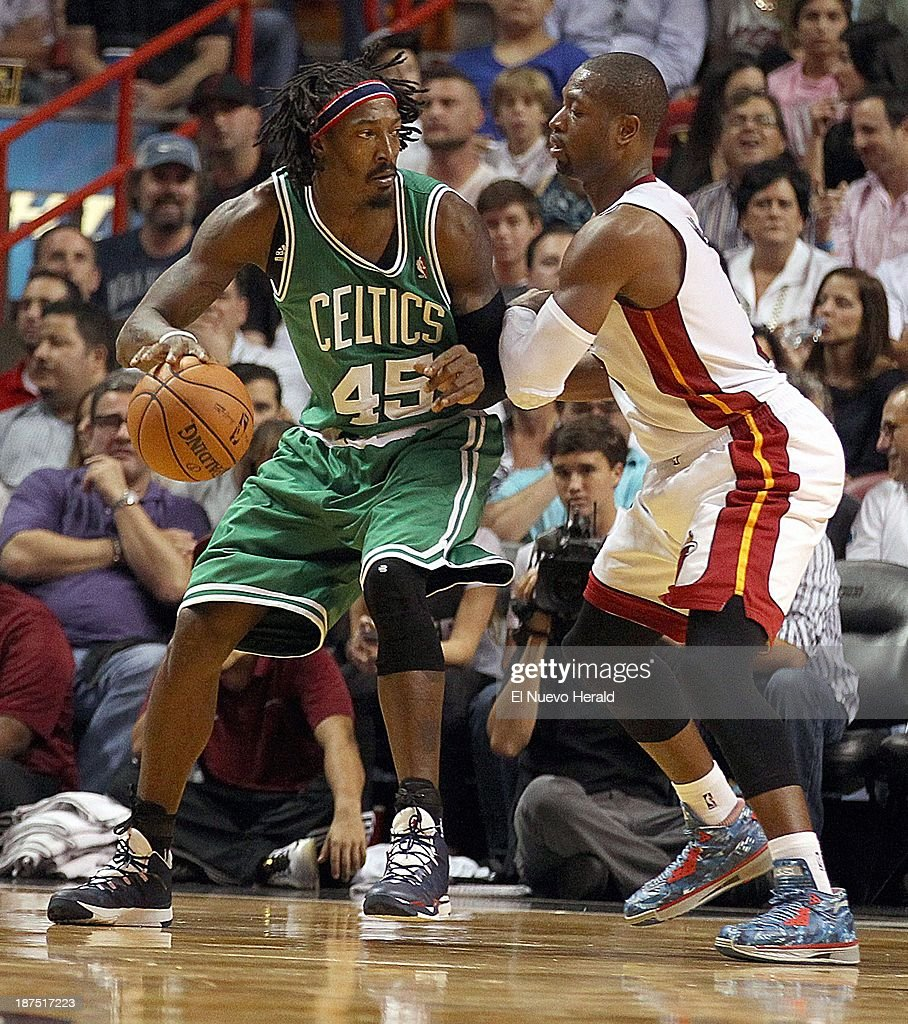 Dwyane Wade of the Miami Heat guards Gerald Wallace of the Boston Celtics during the 4th quarter at the AmericanAirlines Arena in Miami on Saturday, Nov. 9, 2013.