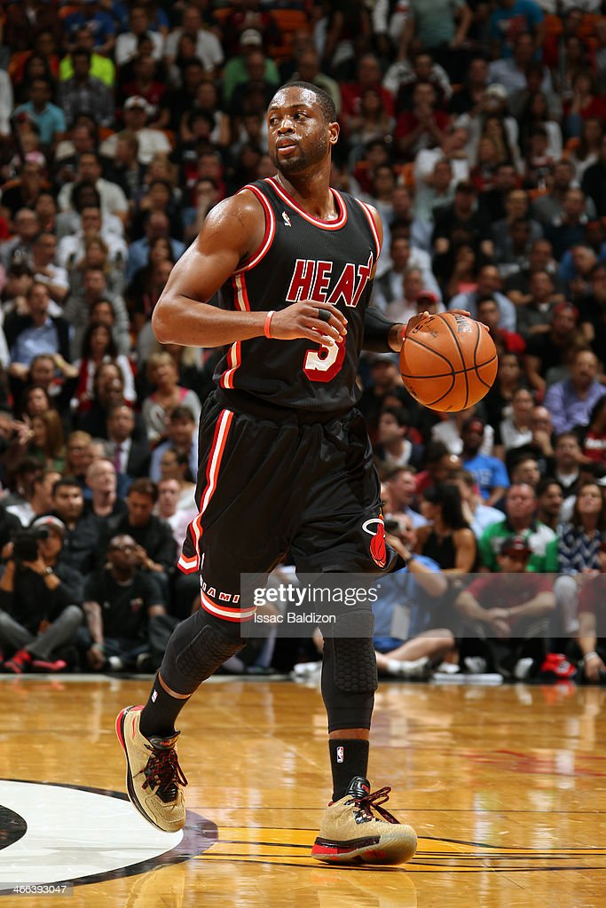 <a gi-track='captionPersonalityLinkClicked' href=/galleries/search?phrase=Dwyane+Wade&family=editorial&specificpeople=201481 ng-click='$event.stopPropagation()'>Dwyane Wade</a> #3 of the Miami Heat handles the ball against the Oklahoma City Thunder at the American Airlines Arena in Miami, Florida on Jan. 29, 2014.