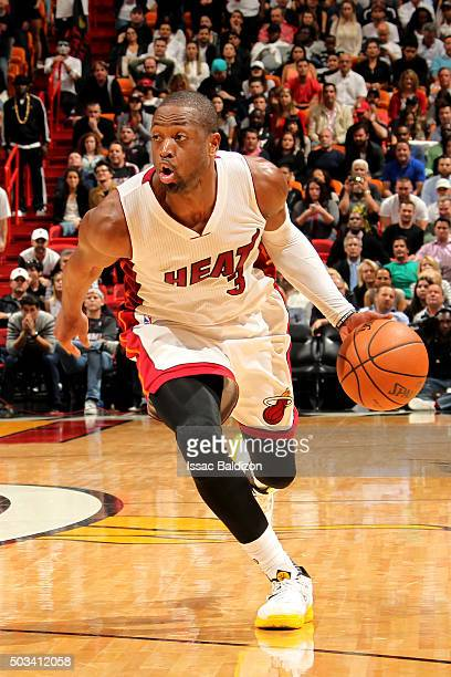 Dwyane Wade of the Miami Heat handles the ball during the game against the Indiana Pacers on January 4 2016 at AmericanAirlines Arena in Miami...