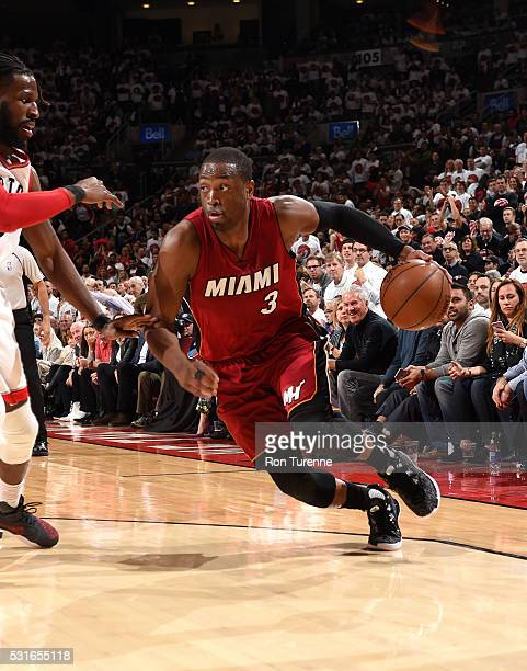Dwyane Wade of the Miami Heat handles the ball during the game against the Toronto Raptors in Game Seven of the Eastern Conference Semifinals during...