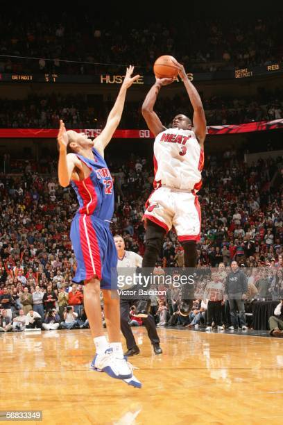 Dwyane Wade of the Miami Heat hits a game winning shot against Tayshaun Prince of the Detroit Pistons on February 12 2006 at American Airlines Arena...